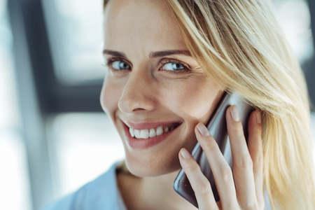 Close up of cheerful woman talking on the phone Stock Photo