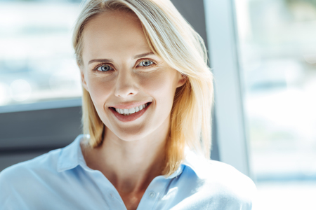 Portrait of a beautiful cheerful fair-haired woman Stock Photo