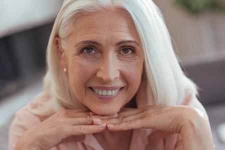 Portrait of a cheerful beautiful aged woman Foto de archivo