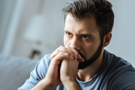 Cheerless thoughtful man feeling lonely