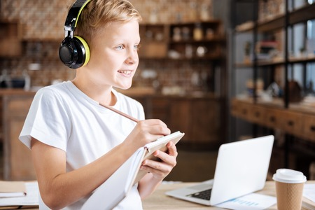 poems: Inspired boy listening to music and writing poems