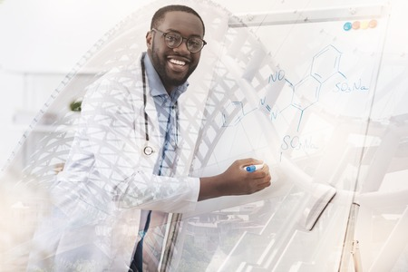 genomics: Excited chemist using marker pen Stock Photo