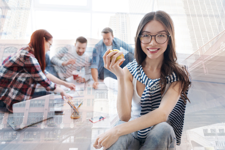 Pretty girl with an apple in hand Stock Photo