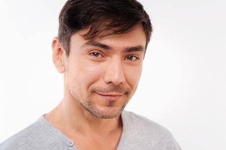 Handsome bristled man posing on white background