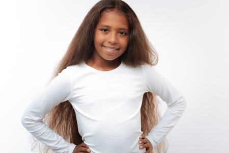 Charming pre-teen girl posing with hands on waist Stock Photo