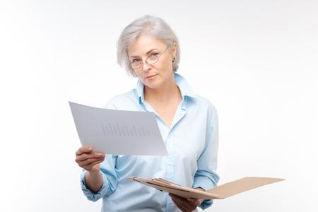 Beautiful woman looking through financial report