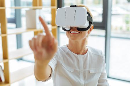 Cheerful positive woman enjoying 3d reality
