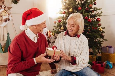 Attentive woman taking little present