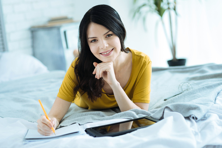 Female freelancer enjoying working from home Stock Photo