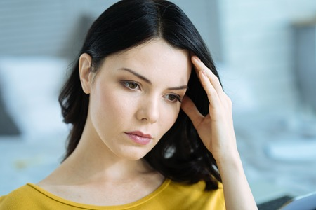 Concerned young woman thinking over something