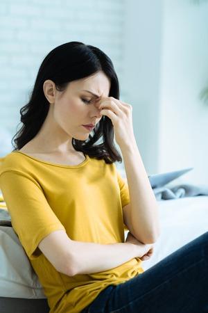 Poor young brunette feeling depressed Stock Photo