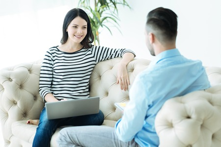 Young couple having pleasant conversation at home
