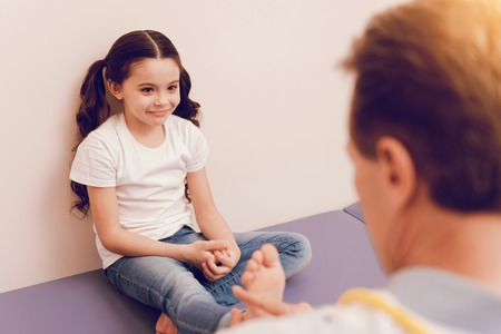 upbringing: Delighted kid looking at her practitioner Stock Photo