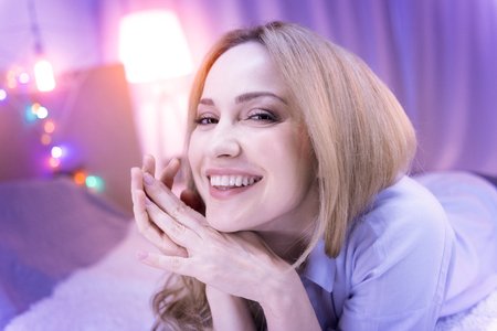 Delighted woman laughing and her eyes shinning Stock Photo