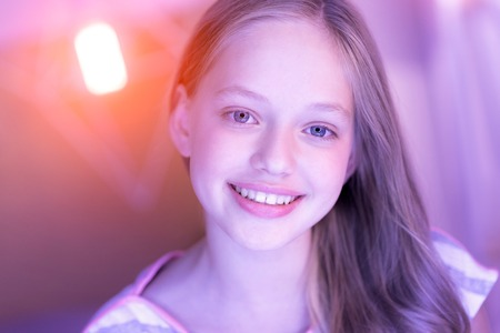 Contend blue-eyed blond girl smiling