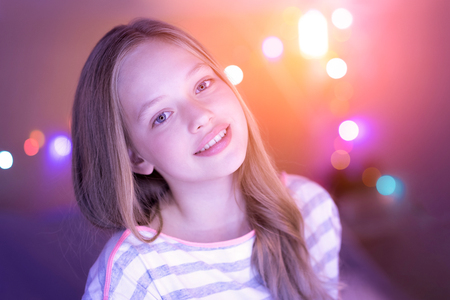 Exuberant girl smiling and her eyes shining Stock Photo