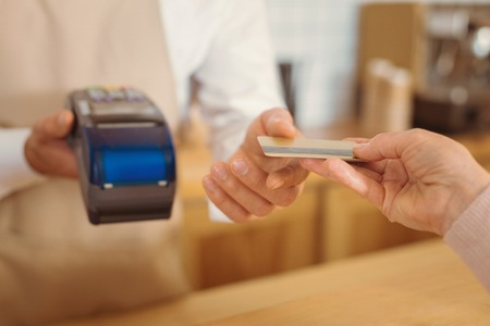 Selective focus credit card being given for payment