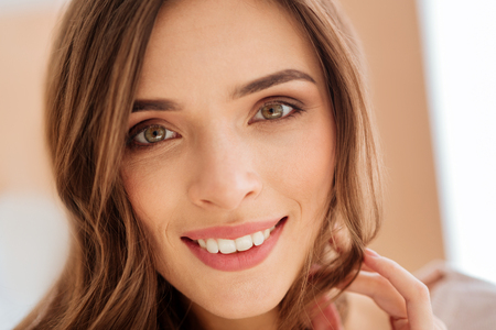 Close up look on beaming young woman