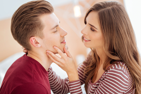 Romantic young people smiling before kiss