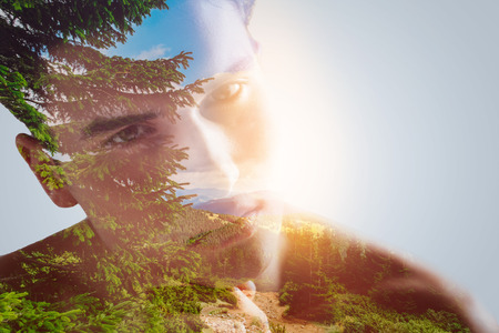 New hope. Double exposure of predatory direct look of guy who seeking for muse  and breathtaking wonderful green landscape which presenting pins Stock Photo