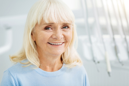 Aspiring to being healthy. Close up of positive woman smiling at you while showing cheerful emotions Stock Photo