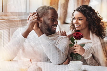 Cheerful young couple looking at each other while expressing happiness and delight Stock Photo