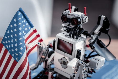 Detailed photo. Interesting machine for playing that staying on the table and holding flag Stock Photo