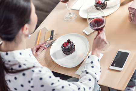Restaurant meal. Top view of a delicious dessert being eaten by a nice pleasant beautiful woman while visiting a restaurant