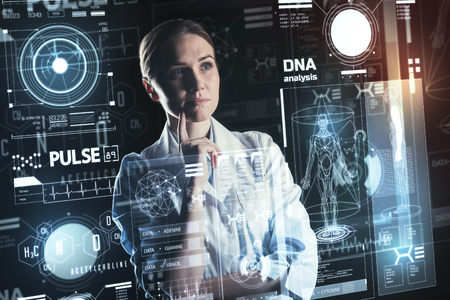 DNA analysis. Smart calm experienced doctor standing with her fingers touching her chin and thoughtfully looking at the results of DNA analysis