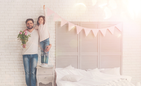 Hello there. Inspiring sincere excited dad and child surprising the mother while having a cool celebration of mothers day Stok Fotoğraf