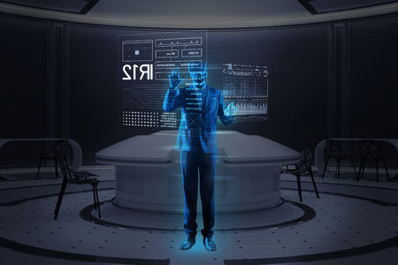Futuristic technologies. Smart qualified young specialist wearing convenient virtual reality glasses and making a realistic hologram image of himself while standing in a modern office