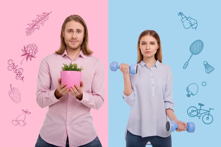 Hobbies. Long haired man holding a flower pot while his girlfriend doing exercises with hand weights