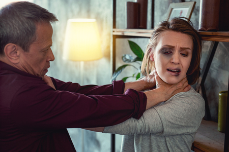 Pushing to wall. Insane crazy husband feeling completely aggressive while pushing his poor wife to the wall