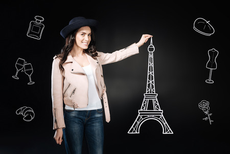 Hello Paris. Happy young woman making her dream come true and taking photos with the beautiful Eiffel tower Standard-Bild - 103373729