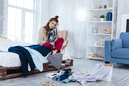 Clothes away. Emotional depressed woman throwing all of the clothes of ex boyfriend away after his betrayal 스톡 콘텐츠