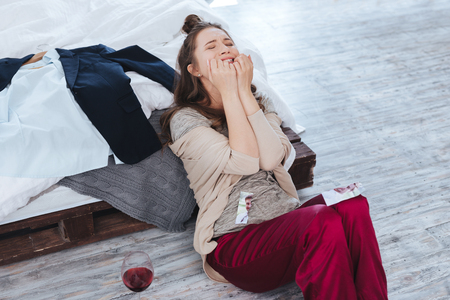 True hysteria. Crying emotional woman feeling terrible while suffering from hysteria after divorce