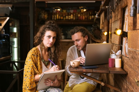 Helpful wife. Helpful wife feeling supportive while assisting her husband while working on menu
