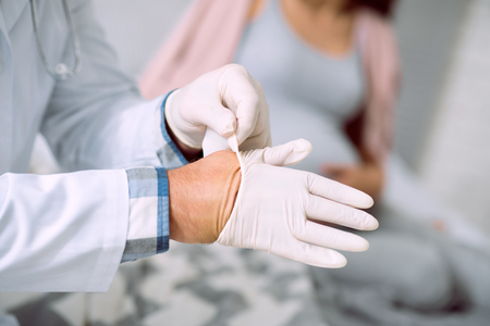 Close up of a rubber glove being put on y a doctor in the hospital