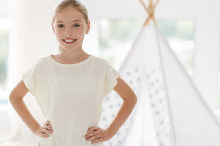 Positive delighted girl keeping smile on her face and looking forward while preparing for fitness