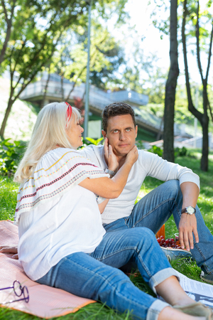 Fed up. Negative delighted man looking upwards while waiting for lunch in park