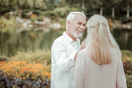 Facial expressions. Pleased male person feeling happiness while having date on nature