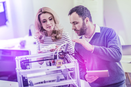 Couple of professional experienced programmers studying cyber security working hard in the office Stock Photo