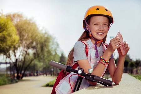 Kind little female expressing positivity while having break Reklamní fotografie