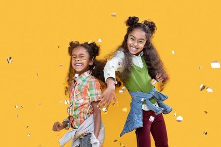 Wonderful mood. Joyful happy girls laughing a lot together while having fun