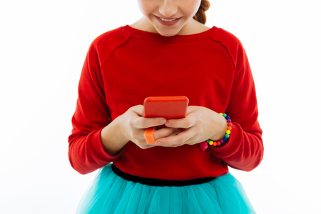 Modern gadgets. Close up of a modern innovative smartphone being in hands of a nice pretty girl