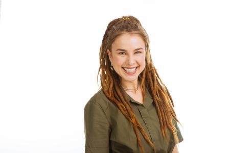 Wonderful mood. Joyful positive woman smiling while expressing her positive emotions Stock Photo