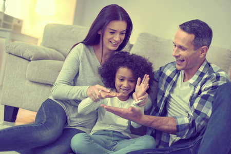 Goofing around. Happy united family playing games together. Stock Photo