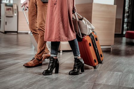 Active life. Two people wearing stylish shoes while going to hotel