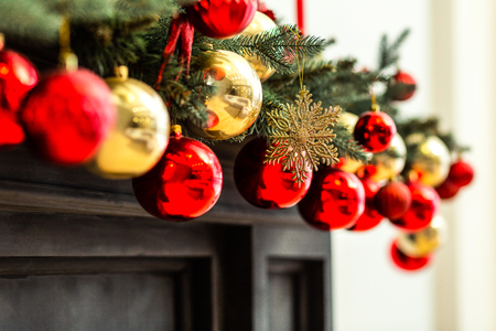 Christmas time. Red and golden christmas ornaments hanging from the decorated christmas tree Stok Fotoğraf