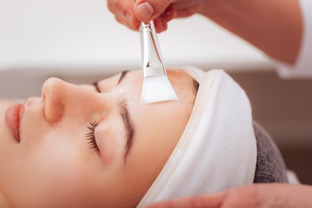 Facial care. Close up of a facial mask being applied with a brush Stock fotó